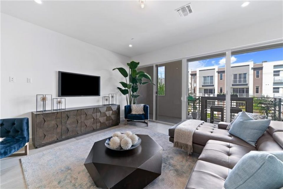 decorated living room in florida loft for sale
