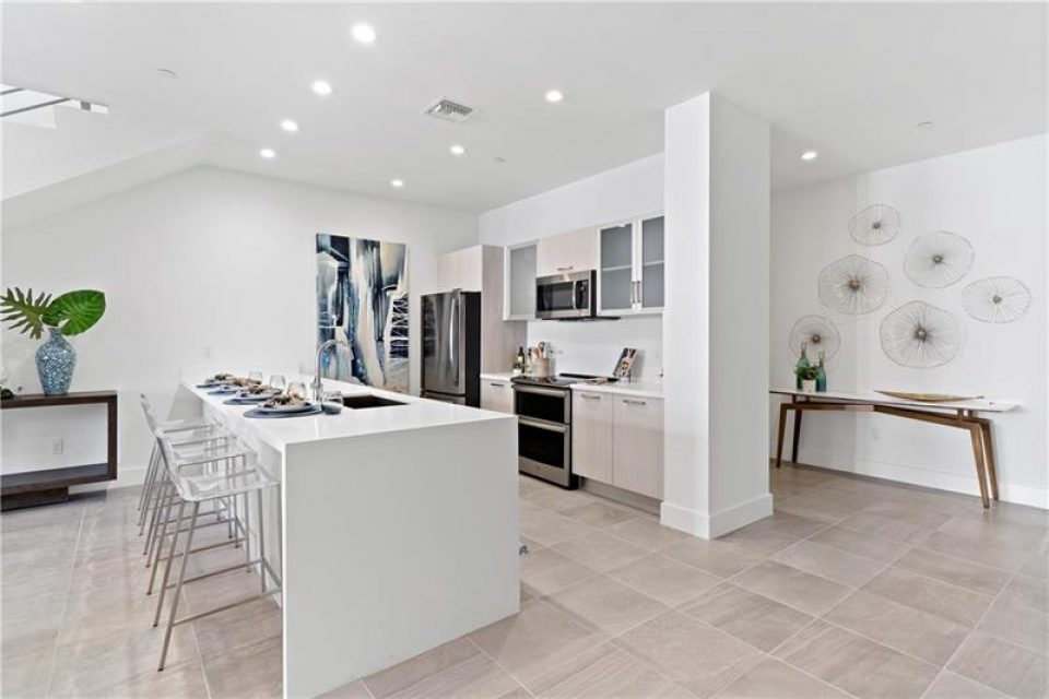 modern kitchen space in florida loft for sale