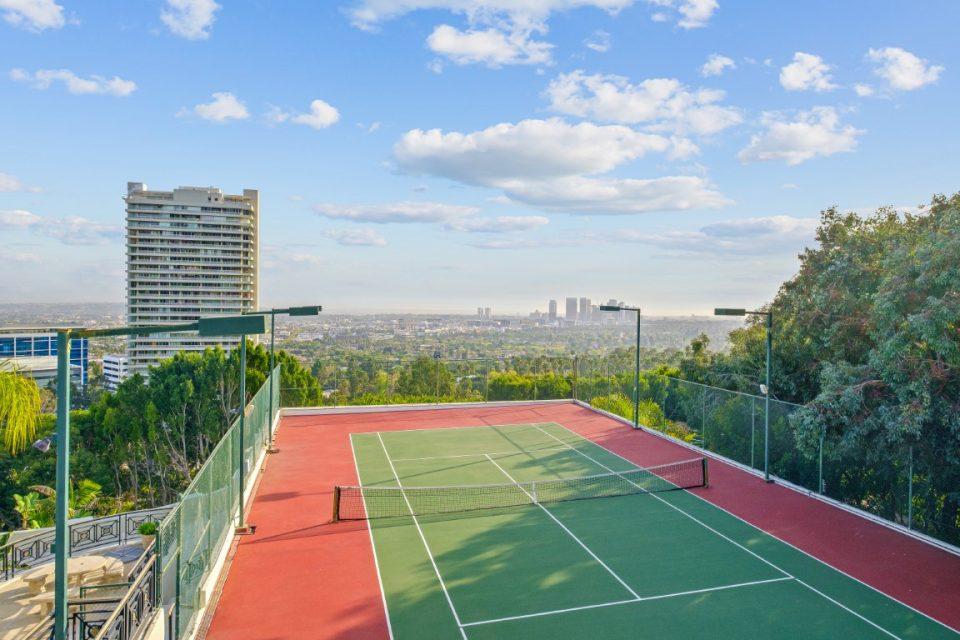 outdoor tennis court overlooking city skyline
